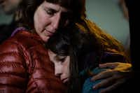 Rachel Kranson holds her daughter, Sasha Kranson, 12, during a vigil after a man fatally shot 11 at Tree of Life Congregation synagogue in Pittsburgh.(Stephanie Strasburg/Pittsburgh Post-Gazette)