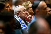 Holocaust survivor Max Glauben listens as Bradley Laye, president and CEO at the Jewish Federation of Greater Dallas, gives remarks during a community service of hope and healing at Congregation Shearith Israel in Dallas on Oct. 28, 2018(Shaban Athuman/Staff Photographer)