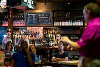 Fathom Realty vice president JR Russell addresses team members during a training session followed by a social hour at  Sherlock's Baker Street Pub in Addison. (Smiley N. Pool/Staff Photographer)
