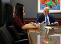 "SettlePou co-founder John D. ""Jay"" Settle talks with Rebekah Wilson, a legal secretary, as Jillian Loh (left front), associate attorney, listens during a meeting at SettlePou.(Vernon Bryant/Staff Photographer)"