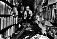 Fire Capt. Don Sturkey inspects the damage caused by the Los Angeles Public Library fire of 1986.  (Boris Yaro/Los Angeles Times)