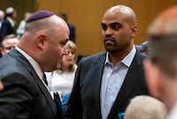 Bradley Laye, president and CEOof the Jewish Federation of Greater Dallas, left, speaks with Democratic congressional candidate Colin Allred following a community service of hope and healing at Congregation Shearith Israel in Dallas on Sunday, Oct. 28, 2018. (Shaban Athuman/Staff Photographer)