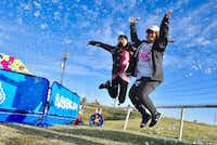 University of Arlington students Rachael Na, 23, left, and Cindy Nguyen, 24, get revved up for the Making Strides Against Breast Cancer 5K on Oct. 28, 2017 near the Margaret Hunt Hill Bridge in Dallas.(Ben Torres/Special Contributor)