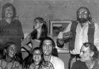 """Edwin """"Bud"""" Shrake (standing, at left), Kathy Lowry Deely and Larry L. King, along with Doatsy Shrake (seated, at left), Holly Gent Palmo, Pete Gent and Billy Lee Brammer in an undated image from <i>Leaving</i><i>the Gay Place.</i>(Sidney and Shelby Brammer/University of Texas Press)"""