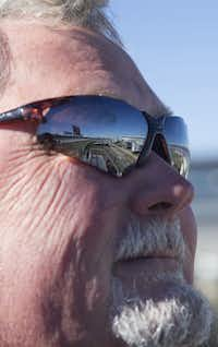 RVs, reflected on Jimmy Martin's sunglasses, parked on the infield at the Texas Motor Speedway,(Daniel Carde/Staff Photographer)