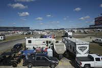 RVs and other vehicles begin to fill the infield at the Texas Motor Speedway in Fort Worth Thursday., (Daniel Carde/Staff Photographer)