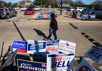 Gubernatorial candidate and former Dallas Sheriff Lupe Valdez walks among campaign signs outside a polling place at Carpenter Park Recreation Center on primary election day on Tuesday, March 6, 2018 in Plano, Texas.(Ashley Landis/Staff Photographer)