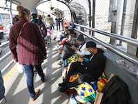 Documented border crossers walk past a group of undocumented migrants waiting to enter the U.S. atop the Paso Del Norte international Bridge between El Paso and Juarez, Mexico on Nov. 1, 2018. Just over 100 migrants were camped out at the bridge waiting to enter the U.S. (Rudy Gutierrez/AP)