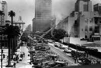 Firefighters battle the fire at the Los Angeles Public Library in 1986.  (Jack Gaunt/Los Angeles Times)