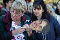 Beto O'Rourke supporters follow a live video live feed to keep track of his scheduled arrival at a Nov. 2 campaign rally at Wayne Frady Park in Lewisville.(Chip Somodevilla/Getty Images)