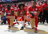 From left: San Francisco 49ers players Eli Harold (58), Colin Kaepernick (7) and Eric Reid (35) kneel during the national anthem before their a game against the Dallas Cowboys on Oct. 2, 2016, at Levi's Stadium in Santa Clara, Calif. (Nhat V. Meyer/Tribune News Service)