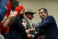 "<p><span style=""font-size: 1em; background-color: transparent;"">U.S. Sen. Ted Cruz (R-TX) greets supporters during a Get Out The Vote Bus Tour rally on Saturday in Victoria, as Victoria County Sheriff T. Michael O'Connor (in Western hat) watches.</span><br></p>(Justin Sullivan/Getty Images)"