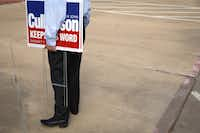 U.S. Rep. John Culberson, R-Texas, holds campaign signs outside the Rummel Creek Elementary polling place on Nov. 6, 2018, in Houston, Texas.(Loren Elliott/Getty Images)