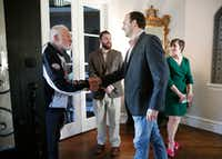 Texas state representative Lance Gooden, right, greets Leslie Read during a campaign fundraiser for Gooden at a home in Dallas on May 11, 2018.(Rose Baca/Staff Photographer)