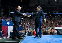 President Donald Trump shakes hands with Sen. Ted Cruz (R-Texas), during a campaign rally for Cruz and other Texas Republicans in Houston, Oct. 22, 2018. (Doug Mills/The New York Times)
