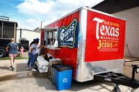 "People order lunch from the Guess Family Barbecue trailer in Waco. The eatery's slogan, ""Old School Texas Barbecue, the Same Kind Jesus Ate,"" was inspired by a customer whom pitmaster Reid Guess was serving.  When asked if he wanted sweet or unsweet tea, the customer responded with an emphatic, ""basic tea, the one Jesus drank.""(Tom Fox/Staff Photographer)"