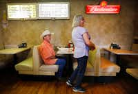 Candace Warden shares a laugh with diner Danny McDonald at Green's Sausage House in Zabcikville, Texas. McDonald has been going to Green's ever since he was a kid. (Tom Fox/Staff Photographer)