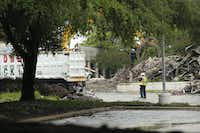 Work crews demolish the former headquarters of the Dallas Cowboys at Valley Ranch in Irving.(Nathan Hunsinger/Staff Photographer)