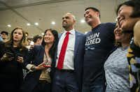 Colin Allred posed for photos with supporters at the Magnolia Hotel in Dallas after winning the election for the 32nd Congressional District over incumbent Pete Sessions.(Ashley Landis/Staff Photographer)
