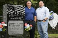 Lowell (right) and Daryl Thompson, the brothers of fallen DART police officer Brent Thompson, photographed at his gravesite on Sunday, June 25, 2017, in Frost.(File Photo/Smiley N. Pool)