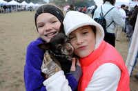"Friends Chloe Johnson and Vivienne Bull snuggled their puppy, Meaty, to keep him warm at a previous Blues, Bandits & <span style=""background-color: transparent; font-size: 0.6875rem;"">Barbeque at Kidd Springs Park.</span>(Alexandra Olivia/Special Contributor)"