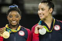 Simone Biles and Aly Raisman of the United States show off their gold and silver medals after the women's gymnastics all-around final at the Rio 2016 Olympic Games on Thursday, Aug. 11, 2016, in Rio de Janeiro.(Smiley N. Pool/Staff Photographer)