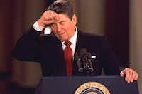 "<p>President Ronald Reagan taps his forehead at the White House while responding to a reporter's question during a news conference on&nbsp;<span style=""font-size: 1em; background-color: transparent;"">&nbsp;March 19, 1987.</span></p><p><br></p>(Dennis Cook/The Associated Press)"