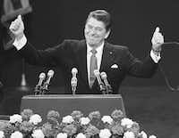 In this July 17, 1980  file photo, Republican presidential candidate Ronald Reagan stands before a cheering Republican National Convention in Detroit's Joe Louis Arena (Rusty Kennedy/AP/(DMN file))