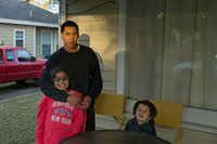 "Guillermo Araujo, first time midterm voter, and his children, Angela, 9, and Roman, 4, at their house in Oak Cliff on Thursday, Nov. 9, 2018. Araujo said he is trying to teach his children not to vote for who is popular but to ""know the candidates and vote for who best represents you.""(Daniel Carde/Staff Photographer)"