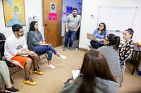 David Sanchez, civics engagement director at Jolt, center, stands and listens during a Jolt workshop to help its canvassers find employment in Garland on Thursday, Nov. 9, 2018.(Shaban Athuman/Staff Photographer)