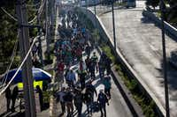 A group of Central American migrants resume their journey north after leaving the temporary shelter at the Jesus Martinez stadium, in Mexico City, Friday, Nov. 9, 2018. About 500 Central American migrants headed out of Mexico City on Friday to embark on the longest and most dangerous leg of their journey to the U.S. border, while thousands more were waiting one day more at the stadium.(Rodrigo Abd/The Associated Press)