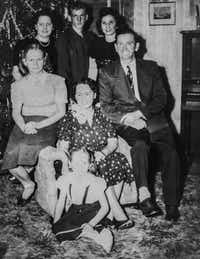 "Albert ""Buddy"" Mills, at top center, with his parents and four sisters in a late 1940s Christmas photo taken at the family home on Dyer Street, near Southern Methodist University.<br>(Courtesy of Eva and Randy Arnold<br>)"