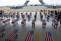 The remains of American soldiers repatriated from North Korea are lined up during a repatriation ceremony after arriving at Joint Base Pearl Harbor-Hickam in Honolulu in August.(AFP/Getty Images)