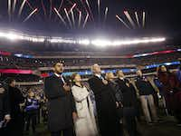 Fireworks explode over Lincoln Financial Field as former President George W. Bush and former first lady Laura Bush stand with decorated U.S. veterans for the national anthem before the Dallas Cowboys-Philadelphia Eagles game Sunday night in Philadelphia. Sunday was Veterans Day.(Tom Fox/Staff Photographer)