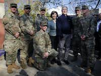 "<p>Former President George W. Bush and former first lady Laura Bush joined serviceman for a group photo before leaving Wharton Square in the Point Breeze neighborhood of Philadelphia on Sunday. Veterans who serve as <span style=""font-size: 1em; background-color: transparent;"">Character Does Matter mentors for the </span><span style=""font-size: 1em; background-color: transparent;"">Travis Manion Foundation planted a pair of dogwood trees and worked on landscaping projects in the neighborhood for Veterans Day.</span></p>(Tom Fox/Staff Photographer)"