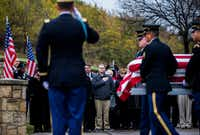 """Family members watch as members of the Army Honor Guard carry a casket containing the remains of Army Corporal Albert """"Buddy"""" Mills at Dallas-Fort Worth National Cemetery on Monday, November 12, 2018. Mills went missing and was killed in action during the Korean War. In July, his remains were found and identified. Family members held a service on Veterans Day, and buried him on Monday.(Ashley Landis/Staff Photographer)"""