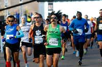 Runners start the BMW Dallas Marathon in downtown Dallas on Dec. 10, 2017.(Nathan Hunsinger/Staff Photographer)