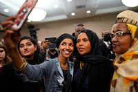 Ilhan Omar (left) poses for selfies with supporters after her victory Nov. 6, 2018, in Minneapolis. Omar is poised to become the first Somali-American elected to Congress, representing Minnesota's Fifth District. (Mark Vancleave/The Associated Press)