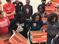 Cynthia Johnson (center), Botham Jean's girlfriend, delivers signatures to District Attorney Faith Johnson's office in Dallas on Sept. 28. She is flanked by Clarise McCants of Color of Change (left) and Sara Mokuria (right) of Mothers Against Police Brutality.(Loyd Brumfield/Staff)