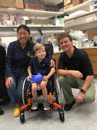 Will Woleben, 6, of McKinney visits with UT Southwestern Medical Center researchers Steven Gray and Qinglan Ling on Aug. 10, 2018. Gray's lab is developing a custom gene therapy that could help Will, who suffers from a rare, genetic illness called Leigh syndrome.(Kasey Woleben)