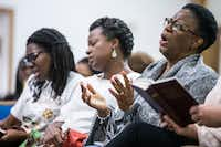 Allison Jean, mother of Botham Jean, sings in September during a prayer vigil for her son at the Dallas West Church of Christ.(Shaban Athuman/Staff Photographer)