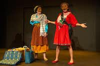 <p>Ana Armenta  (left) and Frida Espinosa Müller in <i>Tina's Journey/El Viaje De Tina</i>, presented by Cara Mia Theatre and Laboraotrio de la Mascara.</p>(Allison Slomowitz/Special Contributor)