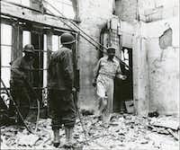 Gen. Douglas MacArthur returns to the ruins of his home atop the once-luxurious Manila Hotel on Feb. 23, 1945. From <i>Rampage: MacArthur, Yamashita and the Battle of Manila, by James M. Scott</i>.(National Archives and Records Administration)