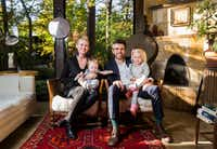 "Danielle and Scott Kaserman and their daughters Gianna, 5 months, and Isabella, 3, pose for a photo in the living room of their Airbnb house affectionately known as the ""tree house"" on Nov. 13, 2018. The home was named the most wish-listed Airbnb in Dallas. (Ashley Landis/Staff Photographer)"