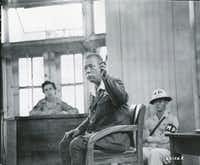Gen. Tomoyuki Yamashita testifies in his defense in a packed Manila courtroom  on Nov. 28, 1945. From <i>Rampage: MacArthur, Yamashita and the Battle of Manila</i>, by James M. Scott.(National Archives and Records Administration)