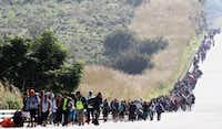 Central American migrants moved toward the United States between Zapopan and Tequila in the Mexican state of Jalisco on November 13.(Ulises Ruiz/Agence France-Presse)