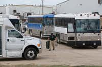 Buses loaded with detained employees exited after Immigration and Customs Enforcement raided Load Trail LLC. trailer manufacturer in Sumner, Texas, on Aug. 28, 2018.(Nathan Hunsinger/Staff Photographer)