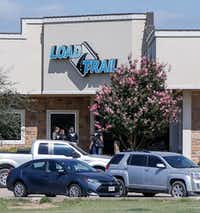 """<p>U.S. Immigration and Customs Enforcement agents stood at the front door of Load Trail<span style=""""font-size: 1em; background-color: transparent;"""">in Sumner, Texas, on Aug. 28, 2018.</span></p>(Lora Arnold/Paris News)"""