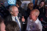 Judges Ken Molberg (left) and John Creuzot celebrate during a Democratic watching party during the March primaries at the Dallasite.  (Rex C. Curry/Special Contributor)