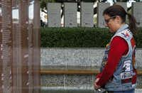 Karoni Forrester stood in front of the Texas Vietnam Veterans Memorial at Fair Park in Dallas in November 2014. She is the daughter of Capt. Ron Forrester, a U.S. Marine who served in Vietnam and remains missing in action. Arthur L. Ruff was critical to making the memorial a reality.(File Photo/Staff)